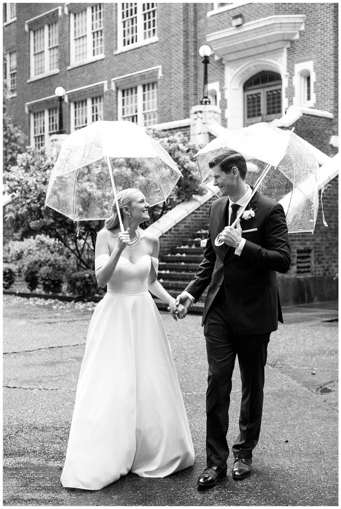 Bride and groom carry umbrellas for Pacific Northwest wedding in Seattle, WA.