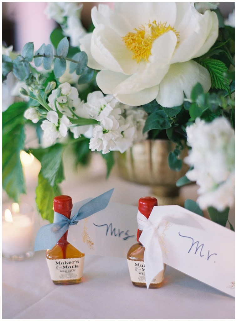 Unique wedding favors fun twist double as place cards on mini bottles of Maker's Mark.