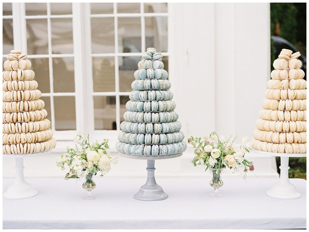 Neutral tones of macarons in towers for wedding dessert alternative. Click for more from this Timeless Coastal Wedding at The Admiral\\\'s House in Seattle, WA. Wedding planning by Perfectly Posh Events, based in Seattle and Portland. Wedding photography by Amanda K Photography. Floral Design by Kaleb Norman James Design. Macarons by Lady Yum. #perfectlyposhevents