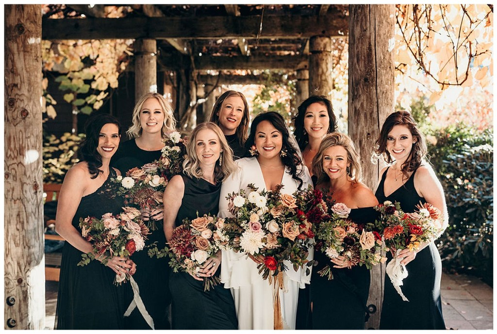 Boho bride with all black bridesmaids dresses with moody and dramatic bouquets at Alderbrook Resort & Spa, WA.