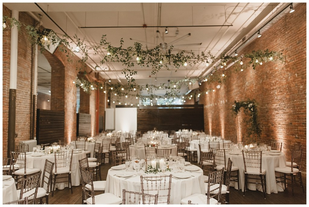Old brick venues in Seattle with string lights for wedding reception. Click to see more from this urban loft wedding design for in wedding at Axis Pioneer Square in Seattle, WA. Wedding planning by Perfectly Posh Events, based in Seattle. Wedding photography by Carina Skrobecki Photography. Greenery by Rusted Vase Co.String Lights by Crimson Haze Event Lighting. #perfectlyposhevents