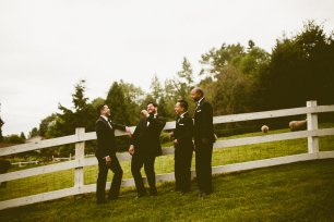 DeLille Cellars wedding in Woodinville | Groomsmen and Groom laughing against white fence | Perfectly Posh Events | Seattle Wedding Planner | Andria Lindquist Photography