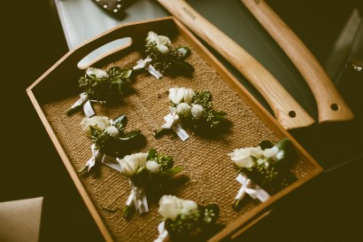 Sodo Park wedding in Seattle | Neutral boutonnieres with greenery | Perfectly Posh Events, Seattle Wedding Planner | Andria Lindquist Photography