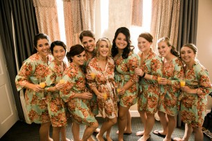 Sodo Park Wedding in Seattle | Bridal party getting ready photo with party in floral robes | Perfectly Posh Events | Kimberly Kay Photography
