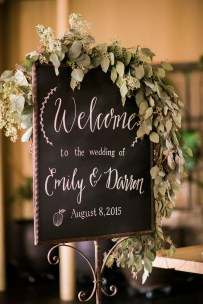 Sodo Park Wedding in Seattle | Calligraphy chalkboard welcome sign with greenery swag | Perfectly Posh Events | Kimberly Kay Photography | Songbird Paperie | Floressence