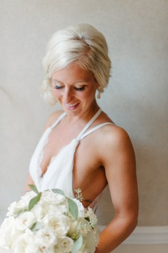 Bride with white bridal bouquet, wedding hair and makeup, Allison Dan Woodinville Wedding by Perfectly Posh Events, Photo by Blue Rose Photography
