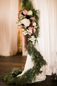 Drape tie back with greenery and flowers | Sodo Park Wedding in Seattle | Wedding Planning and Design by Seattle Wedding Planner Perfectly Posh Events | Kimberly Kay Photography | Floressence