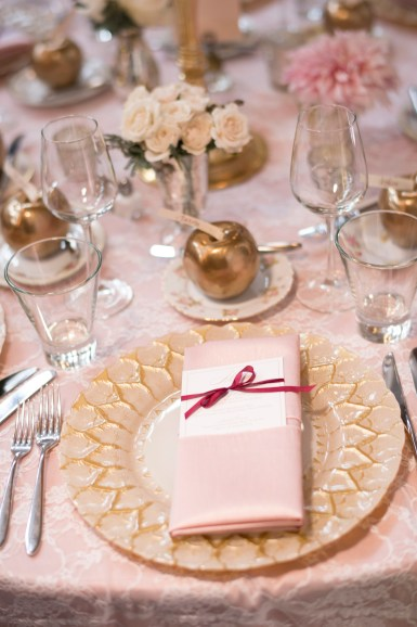 Place setting with gold charger and pink napkin | Sodo Park Wedding in Seattle | Wedding Planning and Design by Seattle Wedding Planner Perfectly Posh Events | Kimberly Kay Photography | Floressence