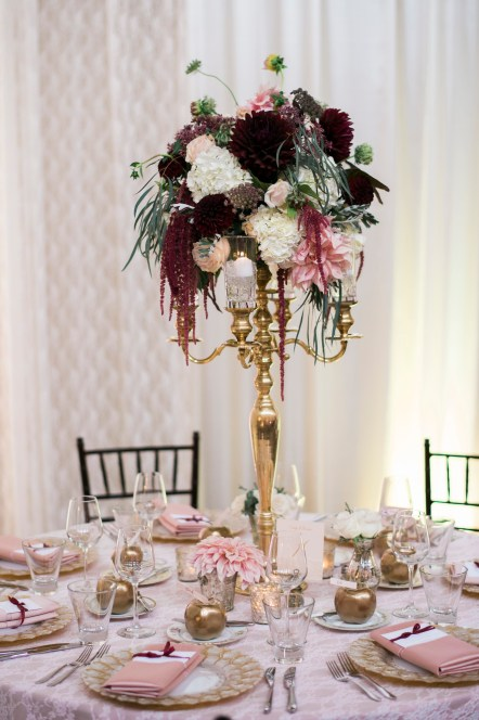 Burgundy, Marsala and blush tall centerpiece | Sodo Park Wedding in Seattle | Wedding Planning and Design by Seattle Wedding Planner Perfectly Posh Events | Kimberly Kay Photography | Floressence