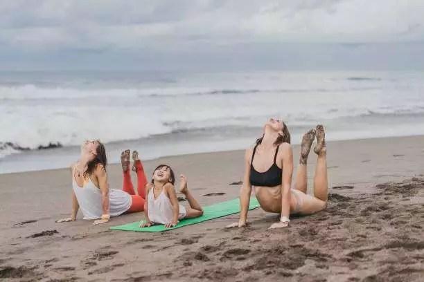 cobra pose beach