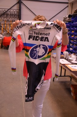 Karen holds up one of the World Champion skin suits