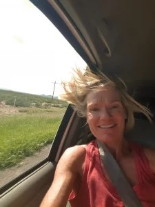 Mia in the backseat, hair blowing in the wind, on the way to Punta de Mita