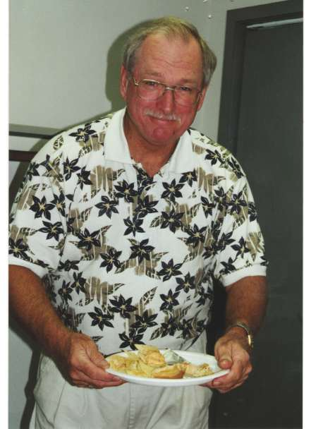 Jules at one of our many office parties - this one probably around 2000 or so.  We have LOTS of pictures of Jules with a plate of food!