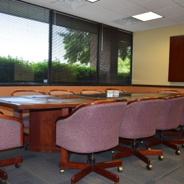 The Jules C. Brazil, Jr., Board Room is professionally designed and furnished with a conference table that seats ten.