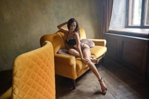 Valery Danko black lingerie on couch