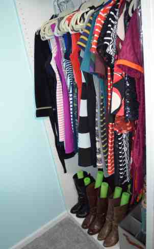 closet with dresses and boots