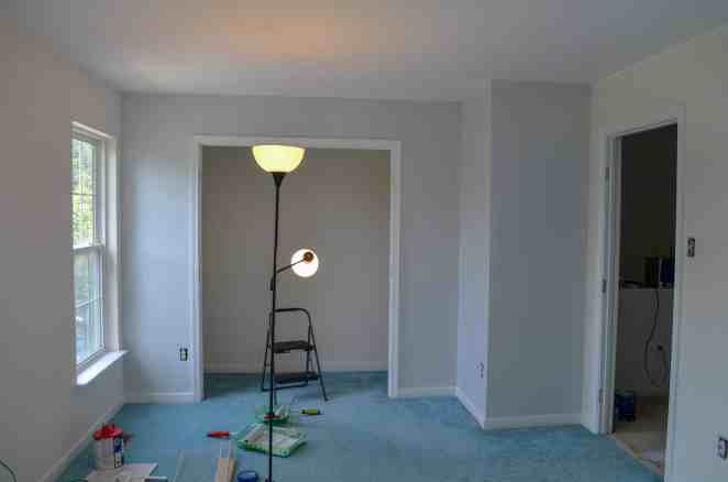one wall painted guest bedroom