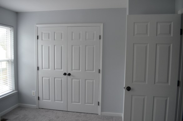 guest room with painted knobs and hinges