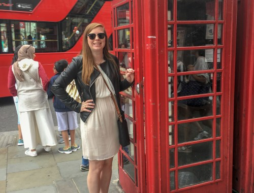 Casey with a red telephone booth