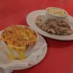 mac & cheese, gouda grits, and pork BBQ