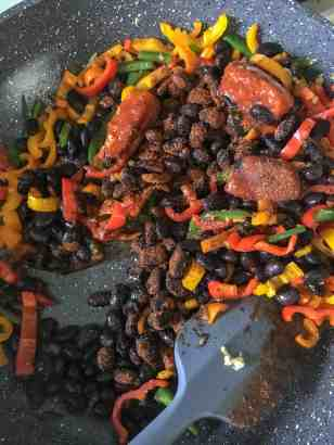 enchilada sauce adds flavor to beans and peppers