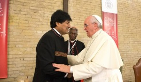 """In this picture released by the Vatican press office,  Pope Francis meets with Bolivia's President Evo Morales and members of a delegation of the Popular Movements in the World on October 28, 2014 at the Vatican. Representatives of more than 100 grassroots movements from all continents gathered at the Vatican.  AFP PHOTO / OSSERVATORE ROMANO RESTRICTED TO EDITORIAL USE - MANDATORY CREDIT """"AFP PHOTO / OSSERVATORE ROMANO"""" - NO MARKETING NO ADVERTISING CAMPAIGNS - DISTRIBUTED AS A SERVICE TO CLIENTS"""