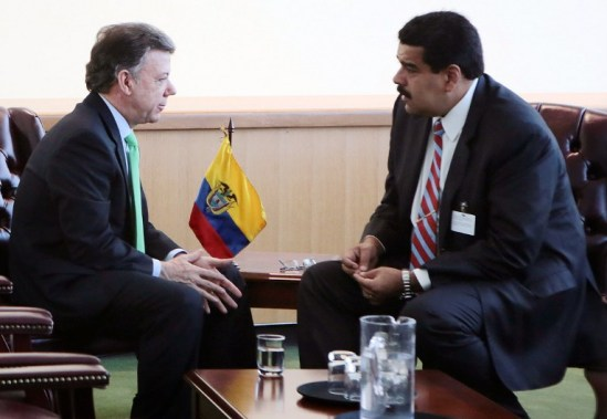 """Venezuelan President Nicolas Maduro (R) speaks with his Colombian counterpart Juan Manuel Santos during a meeting in the sidelines of the 69th UN General Assembly in New York on September 23, 2014.  AFP PHOTO/PRESIDENCIA - MARCELO GARCIA     RESTRICTED TO EDITORIAL USE - MANDATORY CREDIT """"AFP   PHOTO/PRESIDENCIA - MARCELO GARCIA"""" - NO MARKETING NO ADVERTISING CAMPAIGNS - DISTRIBUTED AS A SERVICE TO CLIENTS"""