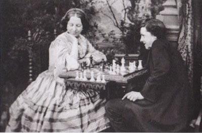 Morphy ante el tablero con la reina Victoria