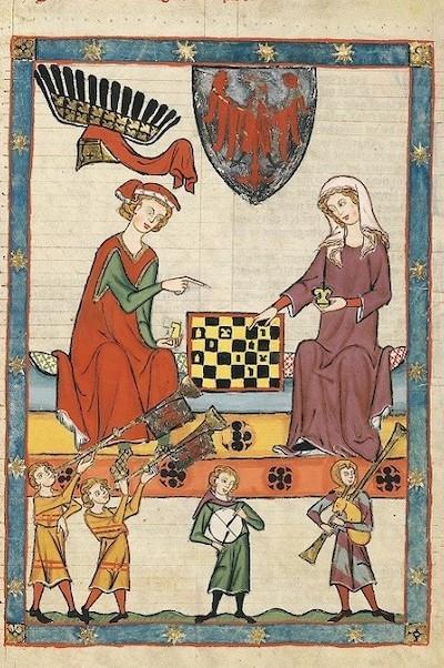 Grabado medieval con una pareja jugando al ajedrez