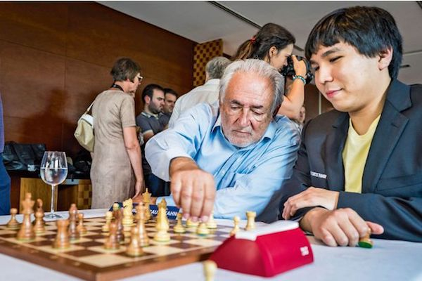 Dominique Strauss Kahn junto a Wesley So.