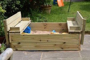 Sandpit with bench