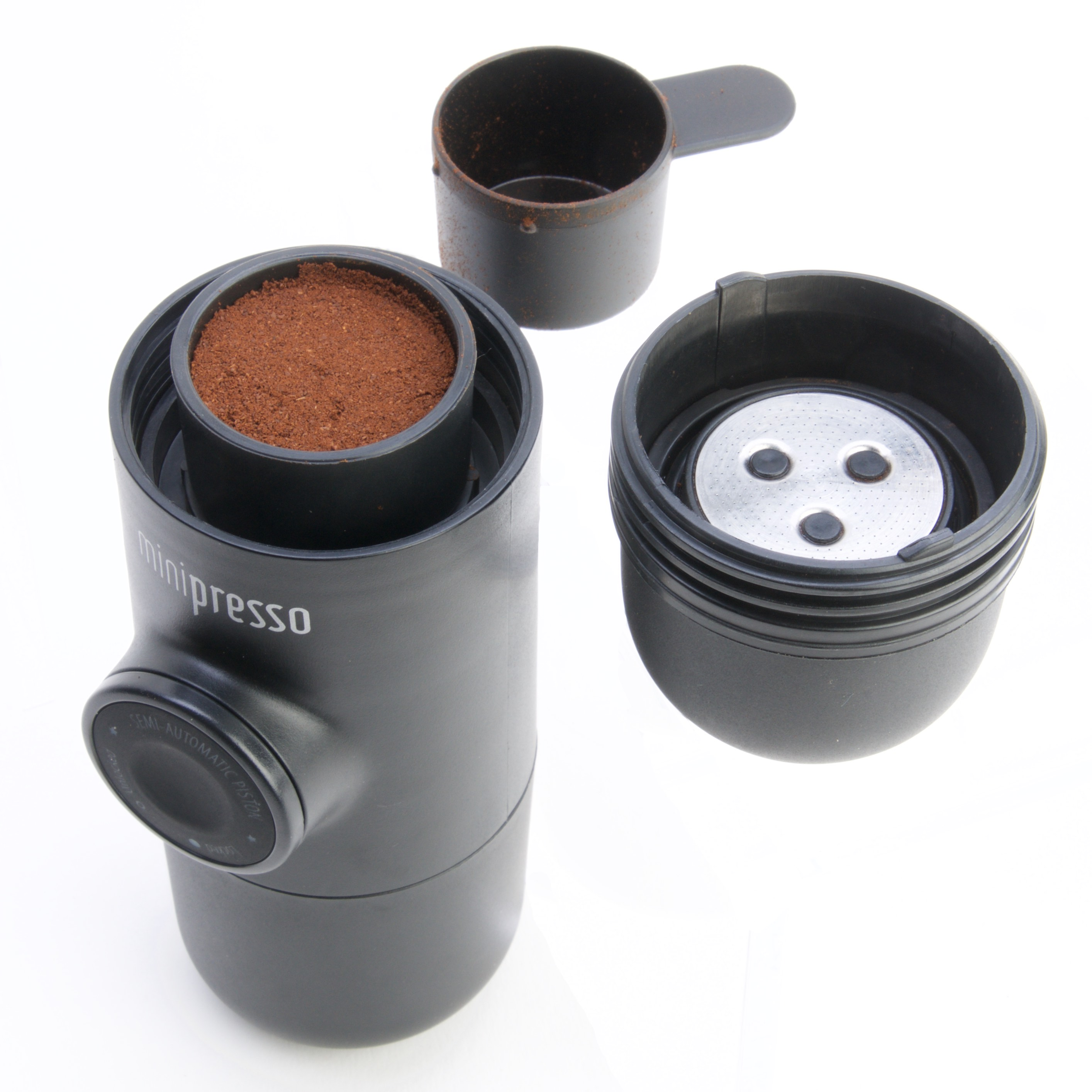 Tamp down the coffee with the scoop, place inside and screw on the outlet end