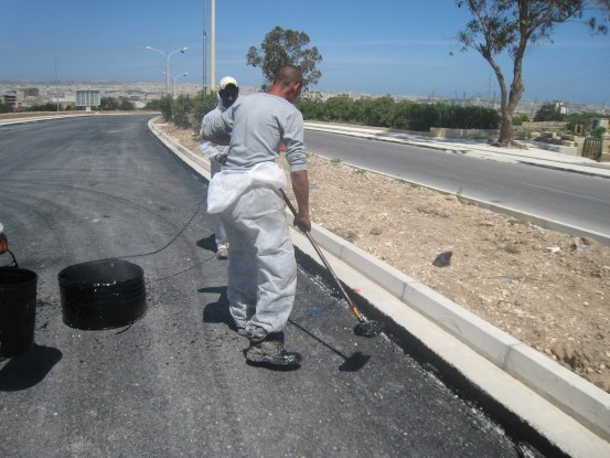 Hot bitumen applied to cold joints