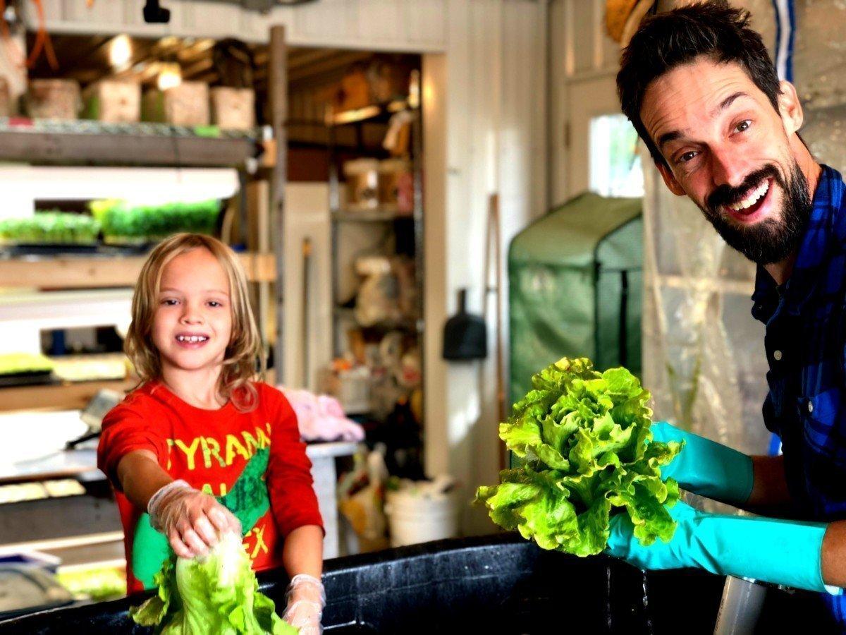 Asher and Dan washing head lettuce