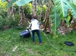 Emily washing the composting toilet