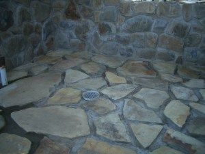 Our bathroom's rock wall and newly laid rock floor