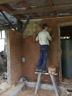 Coating the straw bale