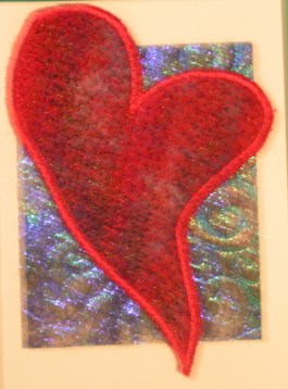 Drizzle Stitch on Felt with Embossed Angelina Fiber Background