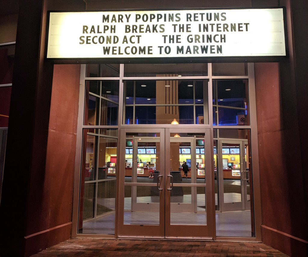 Movie marquee featuring Mary Poppins Retuns (missing the R in returns) and The Grinch.