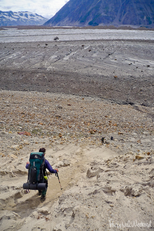 sand skiing down the moraine to the glacier in alaska
