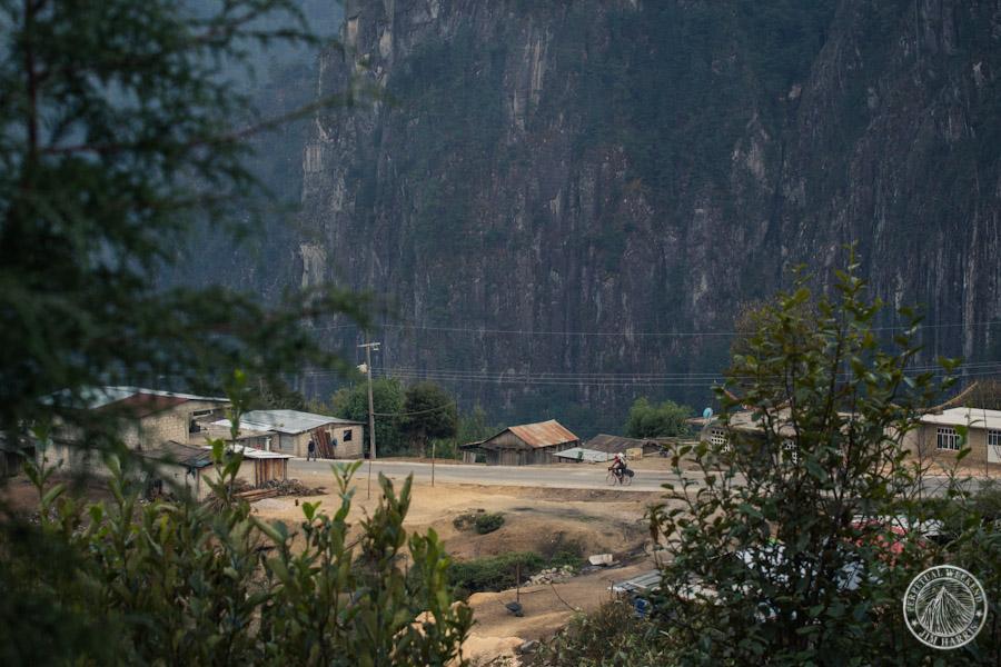 Mehl rides throught a small village near Escola, Mexico