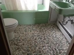 Bathroom with linoleum flooring.