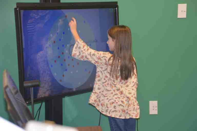 Girl doing vision therapy at eye doctor in Perrysburg, OHio