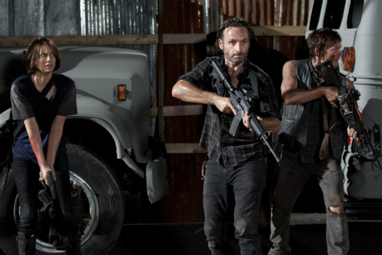 Rick, Maggie, and Daryl holding guns
