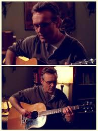Giles playing guitar