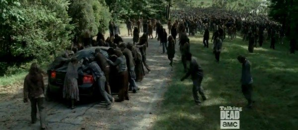 """A horde of walkers surrounds a car in The Walking Dead 4.03 """"Isolation."""""""
