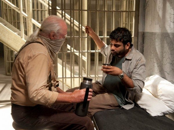 """Hershel Greene (Scott Wilson) and Dr. Subramanian (Sunkrish Bala) talk in a jail cell in The Walking Dead 4.03 """"Isolation."""""""