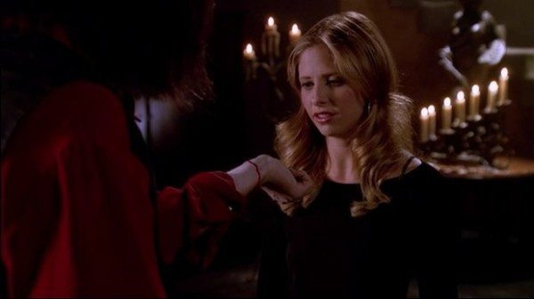 Dracula offers his bleeding wrist to Buffy