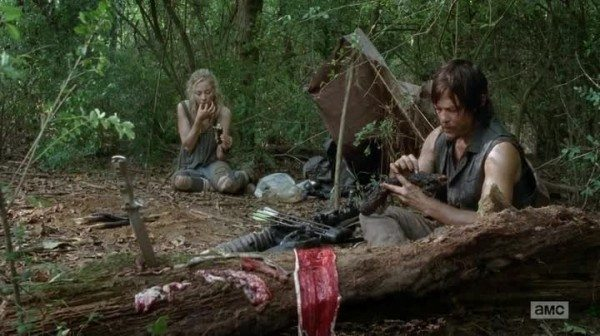 Beth and Daryl make camp in the woods.