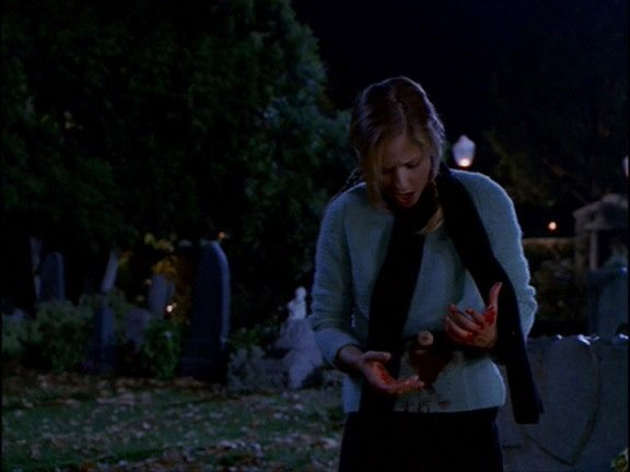 Buffy bleeds from a stake wound to the stomach.